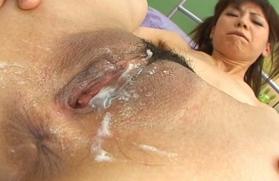 Asian babe with shaved pussy gets her slit stretched and anal screwed